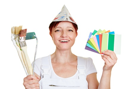color consultant: Happy female painter with color samples and brushes