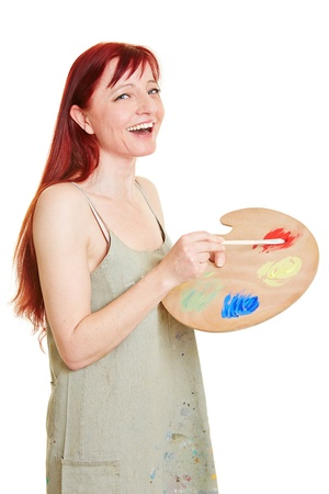 color mixing: Happy female painter with color mixing palette