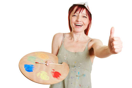 color mixing: Happy woman with color mixing palette holding thumbs up