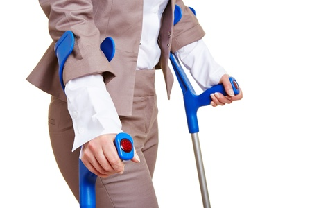paralysis: Hands of a business woman walking with two crutches Stock Photo