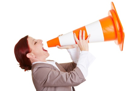 cry for help: Angry business woman shouting in a big traffic cone Stock Photo