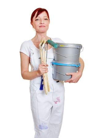 Female painter with two paint buckets and different brushes photo