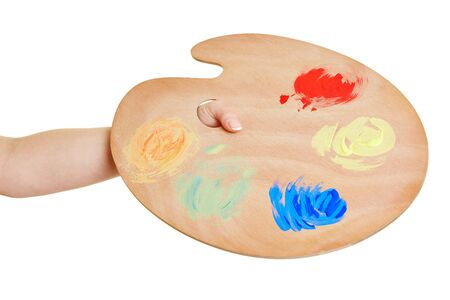 color mixing: Hand holding color mixing palette with oil paint