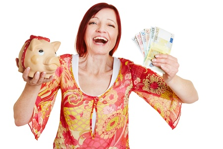 Successful woman cheering with piggy bank and Euro money bills photo
