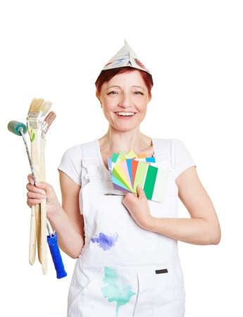 color consultant: Happy woman in painter overall with brushes and color fan