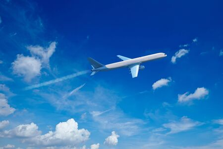 Airplane jet flying in blue sky with clouds photo