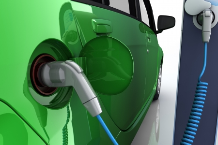 Green electric car at charging station with power outlet photo