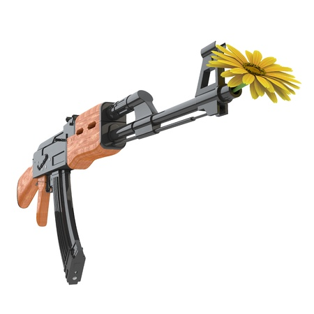 pacifism: A yellow flower in a machine gun as a symbol for pacifism Stock Photo
