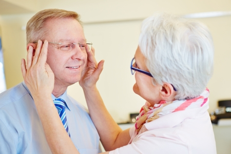 rimless: Senior man testing new rimless glasses at the optician