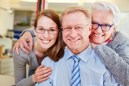 optician: Happy family with seniors at optician with their new glasses