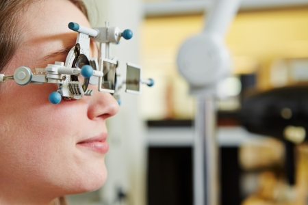 polarization: Woman at optician with trial frame and trial glasses for lens determination Stock Photo
