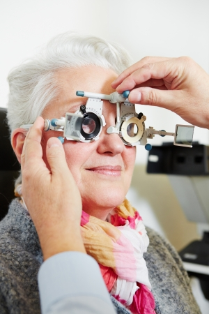 provision: Optician adjusting the trial frame for a senior woman
