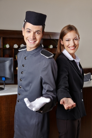 concierge: Concierge and receptionist in hotel offering welcome to guests Stock Photo