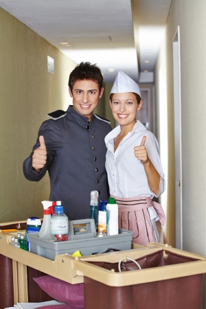 Team of concierge and hotel maid holding their thumbs up Stock Photo - 20104189