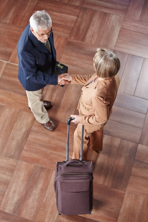 greets: Elderly business people doing handshake as a welcome greeting Stock Photo