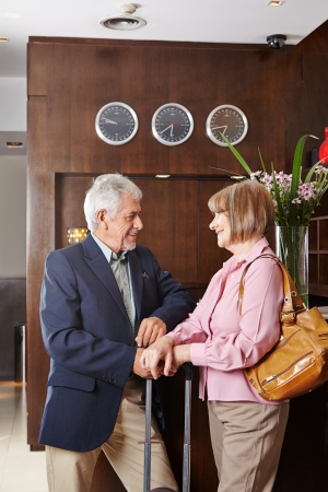 Two seniors waiting at hotel reception for check-in Stock Photo - 20294427