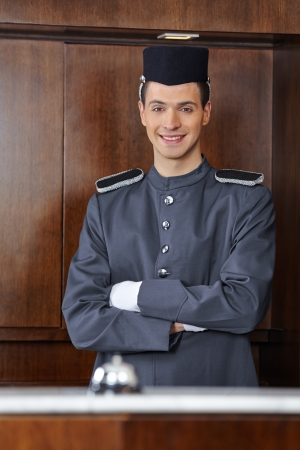Portrait of a concierge in hotel with his arms crossed photo