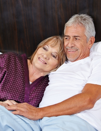 eroticism: Senior couple in love in bed in a hotel room