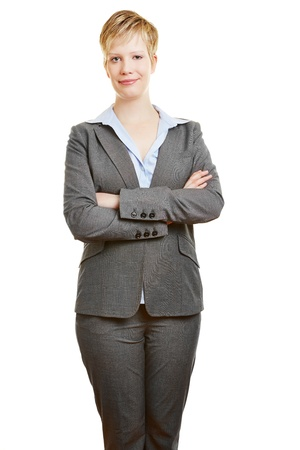 scepticism: Attractive young business woman holding her arms crossed