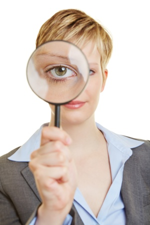 convex: Young woman looking through a magnifying glass with her eye