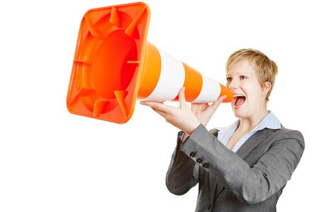 Angry young business woman shouting in a big traffic cone photo