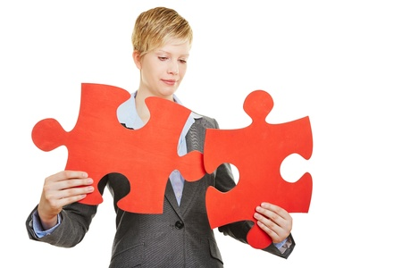 tasks: Business woman with two red jigsaw puzzle pieces Stock Photo