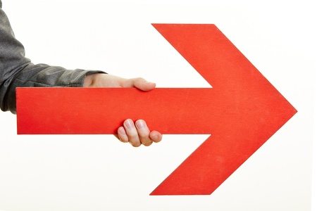right arrow: Hand holding a red arrow pointing to the right