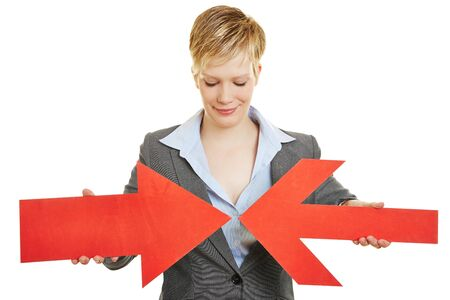 two arrows: Business woman with two big red converging arrows Stock Photo