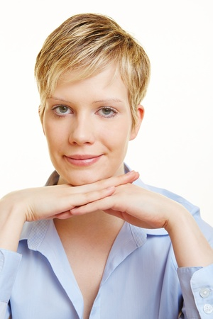 sceptical: Portrait of young attractive blond woman with short hair