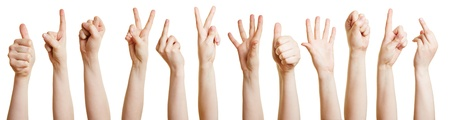 Many hands showing different gestures with the fingers Stock Photo