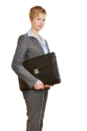 sceptical: Young business woman carrying a briefcase in her arm