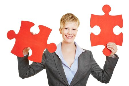 compatible: Happy business woman holding two jigsaw puzzle pieces Stock Photo