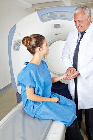 Doctor caring for young patient at MRI therapy photo