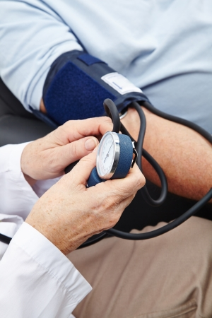 high blood pressure: Doctor measuring the blood pressure at arm of patient