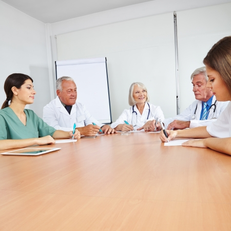 doc: Doctors in a team meeting at a round table Stock Photo