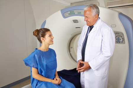 Radiology doctor explaining MRI to patient in a hospital photo