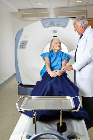 Radiologist talking to a senior woman patient at MRI therapy photo