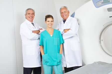 tomography: Team with doctors and nurses in radiology with MRI machine in a hospital