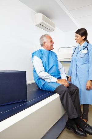 endocrinology: Doctor talking to senior patient before a bone density measurement