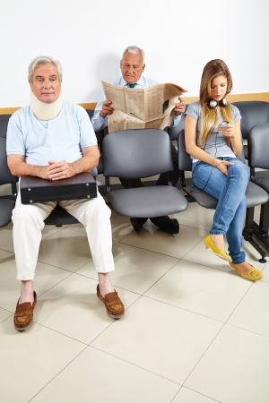 Three patients waiting in a waiting room of a hospital photo