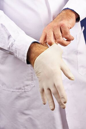 provision: Doctor putting on gloves in a hospital