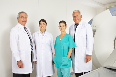 Doctor team with doctors and nurse in radiology in a hospital photo