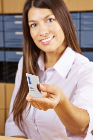 smart card: Happy young woman with smart card at a reception