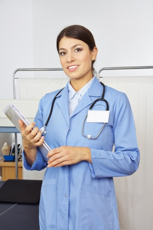 internal medicine: Female doctor with medical records in radiology in a hospital Stock Photo