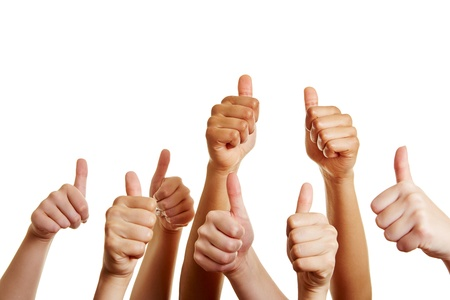 thumb: Group of people holds many thumbs up and congratulates the winner