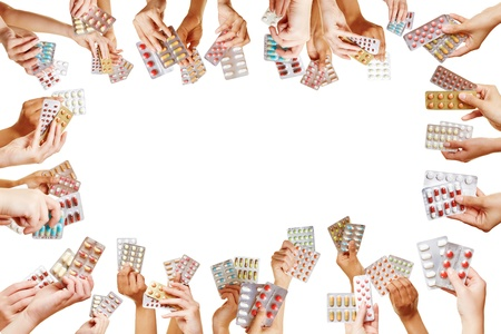 Frame of many hands with different colorful medical pills photo