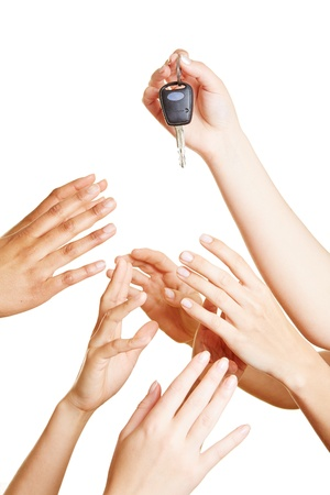 Many desperate hands reaching for car keys photo