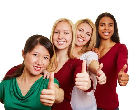 women laughing: Team of smiling multicultural women holding their thumbs up