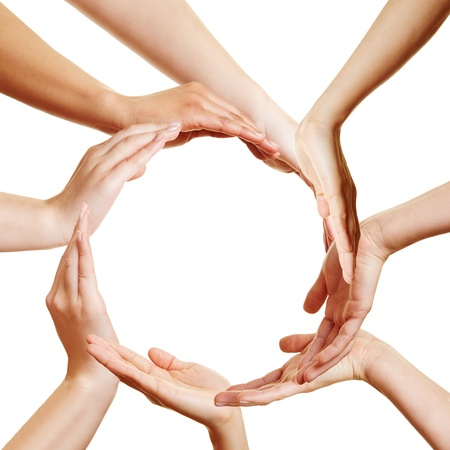 synergy: Team of many hands forming a circle