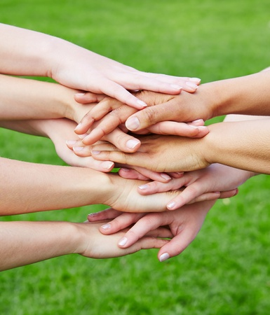 many hands: Team stacking many hands for motivation in green nature Stock Photo